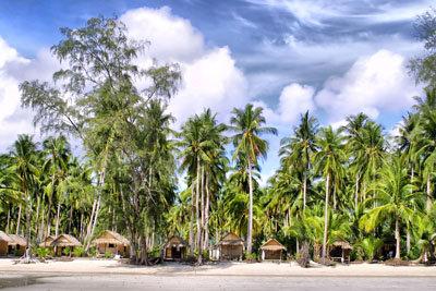 th-koh-chang-beach-lined-with-palm-trees-and-huts