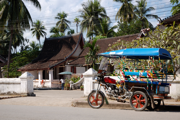 Typical Lao Tuktuk Outside a Local Temple